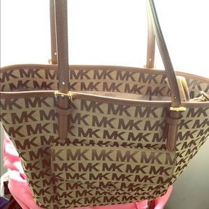 This is a $198  Michael kors still with tag
